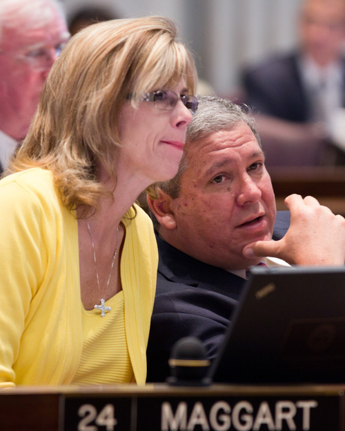 FILE - In this April 25, 2012, file photo, Tennessee House Majority Leader Gerald McCormick and House Republican caucus chairwoman Debra Maggart confer during a House floor session in Nashville, Tenn. The National Rifle Association says it is spending $75,000 to defeat Maggart in this year's Republican primaries because of Republican leadership's failure to pass a bill seeking to guarantee workers the right to store their guns in their cars while at work. (AP Photo/Erik Schelzig, File)