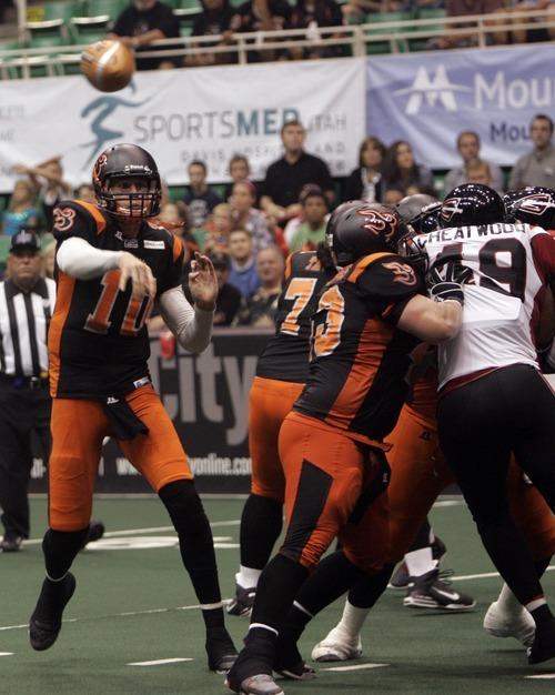 Kim Raff | The Salt Lake Tribune Utah Blaze quarterback Tommy Grady passes the ball against the Cleveland Gladiators during a game at the EnergySolutions Arena in Salt Lake City, Utah on July 13, 2012.