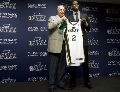 Kim Raff | The Salt Lake Tribune (left) Utah Jazz president Randy Rigby stands on stage with new trade acquisition Marvin Williams during a press conference to introduce Williams at the Jazz practice facility in Salt Lake City, Utah on July 12, 2012.