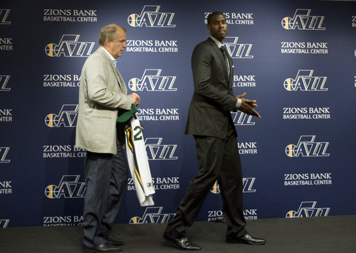 Kim Raff | The Salt Lake Tribune Utah Jazz president Randy Rigby, left, walks on stage with new trade acquisition Marvin Williams during a press conference to introduce Williams on July 12, 2012.