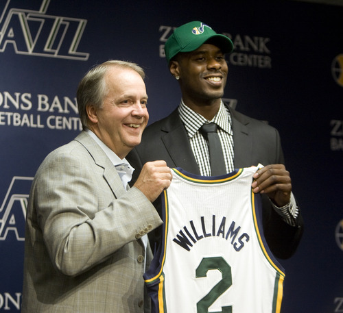 Kim Raff | The Salt Lake Tribune (left) Utah Jazz president Randy Rigby walks on stage with new trade acquisition Marvin Williams during a press conference to introduce Williams at the Jazz practice facility in Salt Lake City, Utah on July 12, 2012.