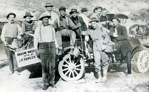 The man in front with a pipe is Tom Winter of Winter Transport Co. Behind him was Walter Watson, manager of Watson Transport Co. The only man in the picture without a hat was John Brown, a detective. William H. Miller, who worked a the old Daynes-Beebe Music Co., was standing at the extreme left. The picture was made in about 1913 during a fishing trip to Peek-A-Book ranch in Bluffdale.