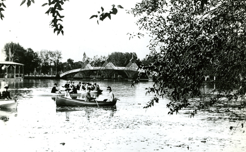 Groups of people take boats out on the lake at Salt Lake's Calders Park--modernly known as Nibley Park--in 1887.
