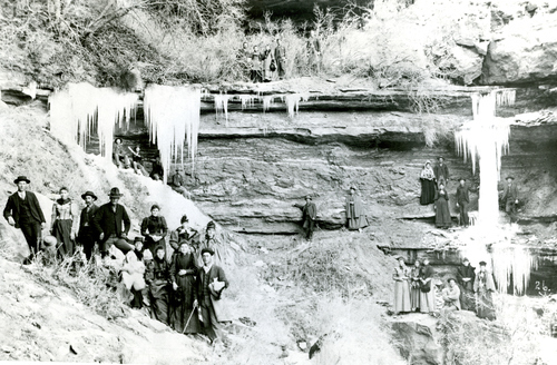 A group enjoys an early-day outing to Dripping Springs in Cow Canyon near Bluff, Utah, 1880. The freezing spring water was put to good use by early settlers of Bluff who would freeze ice cream during their picnics.