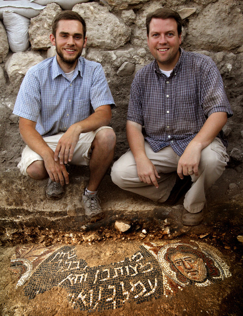 Photo courtesy of Jim Haberman BYU graduate Bryan Bozung, left, and BYU professor Matthew J. Grey with the newly discovered mosaic at an ancient synagogue at Huqoq in Israel. Bozung found the mosaic while volunterring on an excavation of the ancient village of Huqoq on Galilee's western shore.