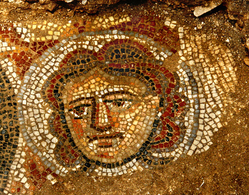 Photo courtesy of Jim Haberman Mosaic depiction of a female face in the Huqoq synagogue. Discovered by BYU graduate Bryan Bozung during excavation in Israel, the mosaic could shed new light on Jewish life and religious worship during the late Roman era.