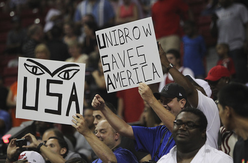 Fans of the USA Basketball Men's National Team member Anthony Davis show their support while taking on the Dominican Republic at the Thomas and Mack Center in Las Vegas on July 12, 2012. (AP Photo/Las Vegas Review-Journal, Jason Bean)