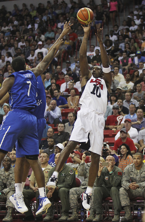 Kobe Bryant (10) of the USA Basketball Men's National Team shoots over the Dominican Republic's Gerardo Suero (7) at the Thomas and Mack Center in Las Vegas on July 12, 2012. (AP Photo/Las Vegas Review-Journal, Jason Bean)