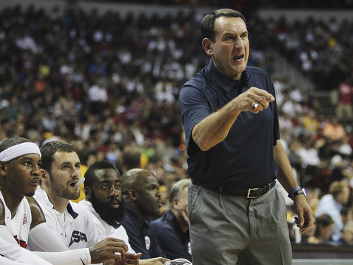 USA Basketball Men's National Team head coach Mike Krzyzewski instructs his team against the Dominican Republic at the Thomas and Mack Center in Las Vegas on July 12, 2012. (AP Photo/Las Vegas Review-Journal, Jason Bean)