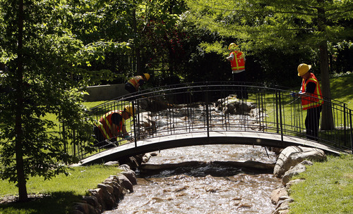 Leah Hogsten  |  Tribune file photo Crews retied booms that had come loose in the rising waters of Red Butte Creek in the Garden Park LDS Ward in June 2010