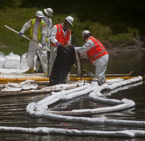 Chris Detrick | Tribune file photo Cleanup crews work along the banks of the pond near the east side of Liberty Park Tuesday, June 15, 2010. after 33,600 gallons of oil spilled into Red Butte Creek.