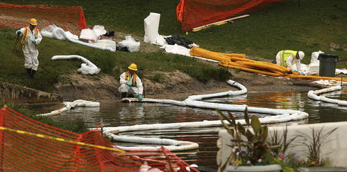 Leah Hogsten  |  Tribune file photo A Chevron pipeline leak in June 2010 flowed into Red Butte Creek, leading to the closure of Liberty Park pond.