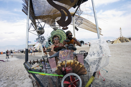 Kim Raff | The Salt Lake Tribune (left) Ian Prowess and Coulson Rich drive an art car around Element 11, a regional Burning Man event, at the Bonneville Sea Base in Tooele County, Utah on July 13, 2012.