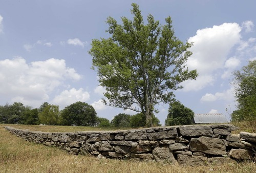 This Monday, July 9, 2012 photo shows a stone wall built during the slavery era in Lebanon, Tenn. The land was once part of a plantation where Jordan Anderson was a slave to Col. Patrick Henry Anderson. The former slave who was freed by Union troops in 1864, spent his remaining 40 years in Ohio. He lived quietly and likely would have been forgotten, if not for a remarkable letter to his former master published in a Cincinnati newspaper shortly after the Civil War. (AP Photo/Mark Humphrey)