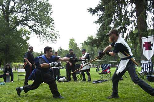 Chris Detrick  |  The Salt Lake Tribune Jack Stewart, left, and Zeb Bjorge compete during the United Clans Swordsman Association sword fighting competition at Liberty Park Saturday July 14, 2012. Twelve people competed in the twice-yearly event.