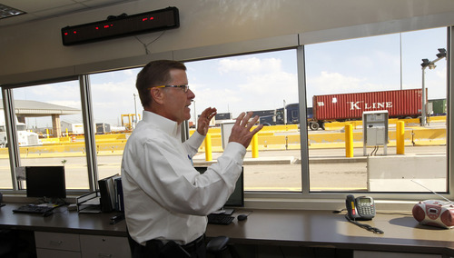 Al Hartmann     The Salt Lake Tribune Phil Faulkner, Union Pacific Director for Intermdodal Operation watches trucks come and go past the automatic gate system at it's intermodal shipping continer hub at 5600 West and 10th South.   The huge hub offloads containers from trains and trucks pickup the loads for delivery. The gate system reads truck idenditification and load information with sensors. Union Pacific is celebrating its 150th birthday this month. Union Pacific has strong ties to Utah with 1,400 employees working in the state.
