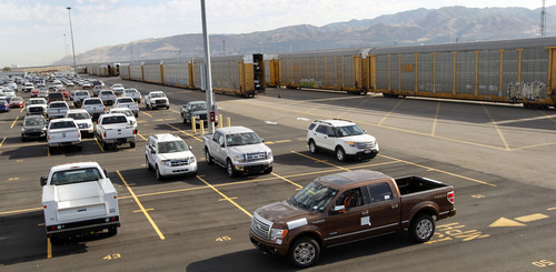 Al Hartmann     The Salt Lake Tribune   New off loaded truck is driven from enclosed railcar at the Union Pacific's vehicle distribution center.   It's one of 23 in the Union Pacific system.  Thursday July 12 about 30 enclosed ralroad cars full of new cars and trucks were unloaded.  The new cars are then reloaded onto trucks to deliver to car dealerships around the state.  Union Pacific is celebrating its 150th birthday this month. UP has strong ties to Utah.  Union Pacific is celebrating its 150th birthday this month. Union Pacific has strong ties to Utah with 1,400 employees working in the state.