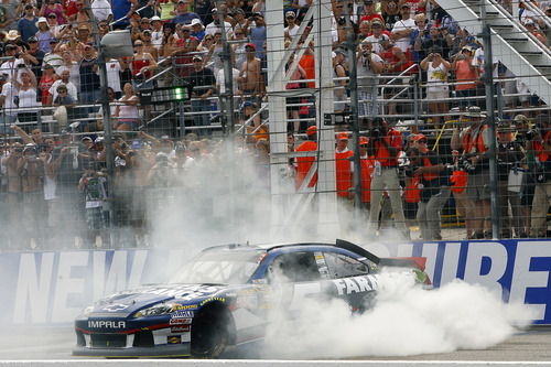 Kasey Kahne performs a burnout after winning the NASCAR Sprint Cup Series auto race at New Hampshire Motor Speedway, Sunday, July 15, 2012, in Loudon, N.H. (AP Photo/Autostock, Matthew T. Thacker) MANDATORY CREDIT