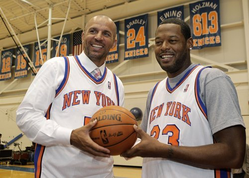 FILE - In this July 12, 2012 file photo, Jason Kidd, left, and Marcus Camby pose for a photograph following a news conference to introduce the New York Knicks' newest additions at the team's NBA basketball training facility in Tarrytown, N.Y. Kidd was arrested by Southampton, N.Y., police for alleged drunk driving after crashing his sports utility vehicle into a telephone pole, Sunday, July 15. (AP Photo/Kathy Willens, File)