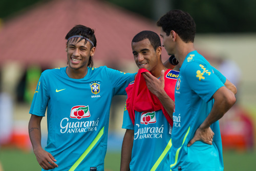Brazil's Neymar, left, jokes with teammates Lucas, center and Ganso during a training session in preparation for the London 2012 Olympics in Rio de Janeiro, Brazil, Wednesday July  11, 2012. (AP Photo/Felipe Dana)