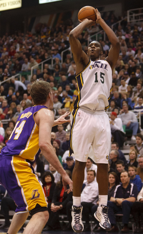 Trent Nelson  |  The Salt Lake Tribune Utah Jazz forward Derrick Favors (15) shoots over Los Angeles Lakers' Troy Murphy (14) as the Utah Jazz host the Los Angeles Lakers, NBA basketball Saturday, February 4, 2012 at EnergySolutions Arena in Salt Lake City, Utah.