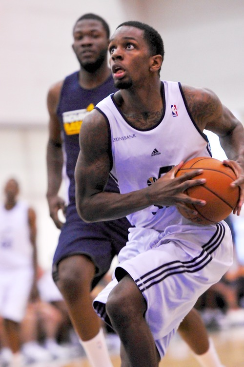Kevin Murphy of the Utah Jazz drives to the basket against the Indiana Pacers during the Orlando Summer League games Thursday, July 12, 2012 in Orlando, Florida.  (Photo by Roberto Gonzalez|Special to the Tribune)