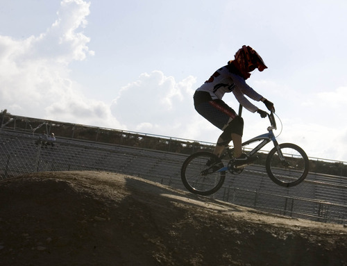 Paul Fraughton | The Salt Lake Tribune Arielle Martin, who will represent the U.S. in BMX at the London Olympics, takes a few laps on the RAD Canyon BMX Track in South Jordan, where she raced as a kid.