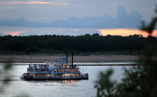 In this July 13, 2012, photo, the Memphis Queen riverboat moves up the Mississippi River in Memphis, Tenn.  A year after nearly record floods, the Mississippi River level has dropped so low that it's beginning to affect commercial operations. Port managers worry that their passages to the river could fill up with silt, and barge operators may have to lighten their loads. (AP Photo/Nikki Boertman)