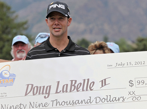 Lennie Mahler  |  The Salt Lake Tribune Doug LaBelle II is awarded a $99,000 check after winning the Web.com Golf Tour at Willow Creek Country Club in Sandy, Utah. Sunday, July 15, 2012.