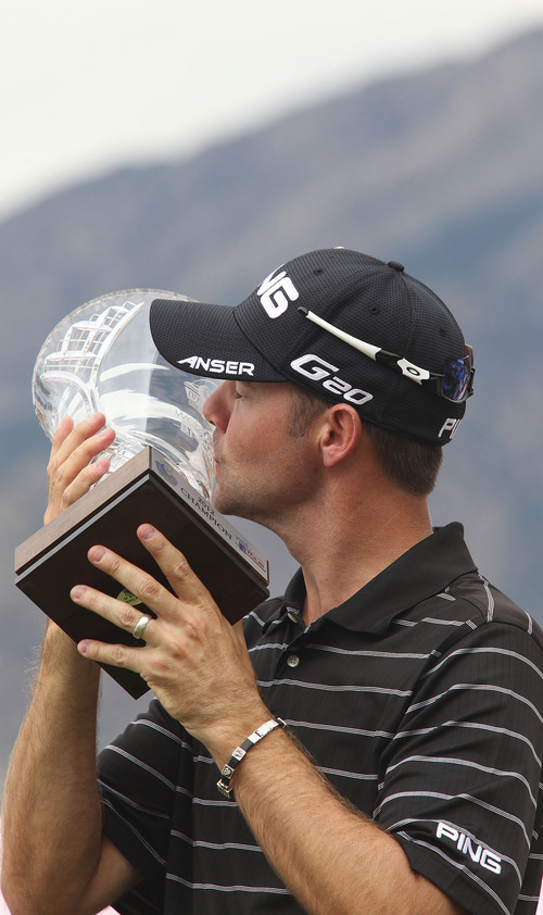 Lennie Mahler  |  The Salt Lake Tribune Doug LaBelle II kisses the 2012 Web.com Championship trophy after winning the tour at Willow Creek Country Club in Sandy, Utah. Sunday, July 15, 2012.