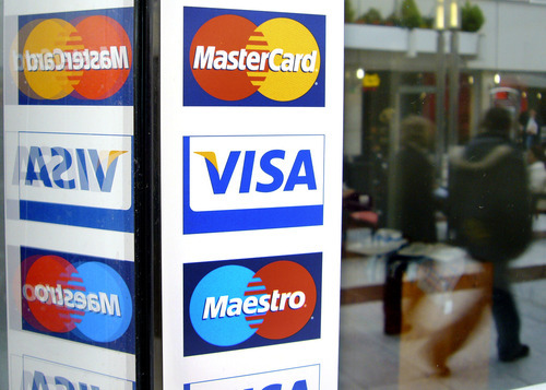 (AP Photo/Michael Probst, File) The tentative deal allows merchants to offer discounts to customers paying with cash or checks and to impose fees when they pay with credit cards. Businesses can also negotiate directly with Visa and MasterCard over the rates they pay for credit card transactions.