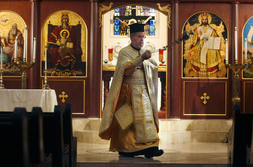 Scott Sommerdorf  |  The Salt Lake Tribune              Rev. Matthew Gilbert conducts service in his vestments at Holy Trinity Greek Orthodox Cathedral in Salt Lake City, Saturday, June 30, 2012.