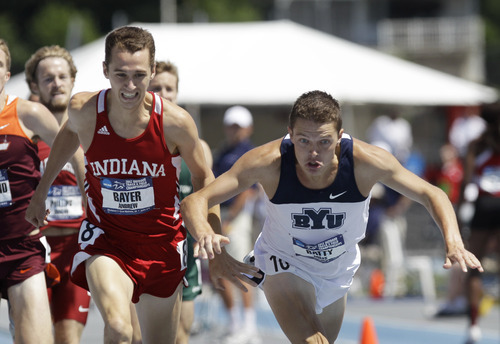 Indiana's Andrew Bayer, left, and BYU's Miles Batty, right, fight to the finish line during the men's 1,500-meter run at the NCAA outdoor track and field championships, Saturday, June 9, 2012, at Drake Stadium in Des Moines, Iowa.  Bayer won the race in 3:43.82. (AP Photo/Charlie Neibergall)
