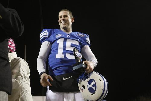 BYU quarterback Max Hall holds the Las Vegas Bowl MVP trophy.  Chris Detrick | The Salt Lake Tribune