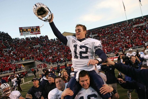 BYU quarterback John Beck is carried off the field after the comeback win. Salt Lake City - Utah vs. BYU college football at Rice-Eccles Stadium. Photo by Trent Nelson; 11.25.2006