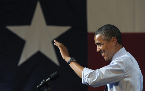 President Barack Obama waves to the crowd as he arrives to speak at a fundraising event at the Austin Music Hall in Austin, Texas, Tuesday, July 17, 2012. Obama is spending the day fundraising in Texas. (AP Photo/Susan Walsh)