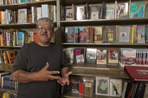 In this photo taken Monday, Sept. 12, 2011, writer and activist Luis J. Rodriguez poses for a photo at his independent bookstore and community center