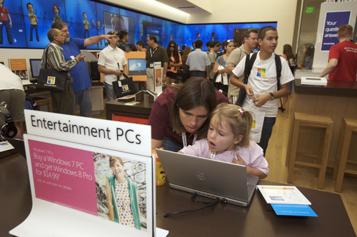 Customers attend the gran opening of a Microsoft Store in Danbury, Conn. (AP photo)