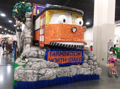Trains are a popular theme among the Days of '47 Parade floats, but this one by the Farmington North Stake takes a different approach: A tunnel, with a trolley coming out one end and a FrontRunner train coming out the other. (Photo by Sean P. Means  |  The Salt Lake Tribune)