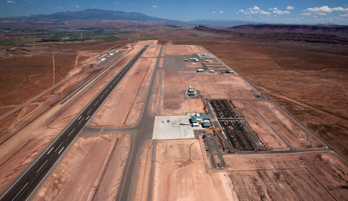 An aerial view shows the St. George Municipal Airport Tuesday, July 17, 2012.  A SkyWest Airlines employee wanted in a murder case attempted to steal a passenger plane, then shot himself in the head after crashing the aircraft in a nearby parking lot, officials said Tuesday. Brian Hedglin, 40, scaled a razor wire fence at the St. George Municipal Airport early Tuesday, then boarded the 50-passenger SkyWest jet while the airport was closed, St. George city spokesman Marc Mortenson said.  (AP Photo/The Spectrum, Jud Burkett)