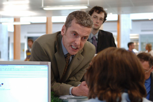 This 2005 picture provided by BBC Worldwide Americas and Hulu shows Peter Capaldi, center, portraying Malcolm Tucker and Chris Addison as Ollie Reeder in the British political comedy