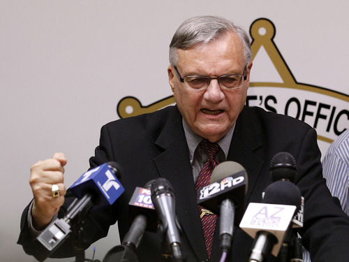 In this May 10, 2012 file photo, a defiant Maricopa County Sheriff Joe Arpaio pounds his fist on the podium as he answers questions regarding the Department of Justice announcing a federal civil lawsuit against Arpaio and his department, during a news conference in Phoenix.  For six years, the self-proclaimed toughest sheriff in America has vehemently denied allegations that his deputies racially profile Latinos in his trademark immigration patrols. Now, Arpaio will have to convince a federal judge who is presiding over a lawsuit that heads to trial on Thursday, July 19, 2012 and is expected to last until early August. (AP Photo/Ross D. Franklin, File)
