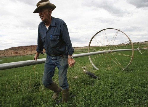 Leah Hogsten  |  The Salt Lake Tribune Alalfa farmer Kay Hickman moves his irrigation lines Thursday July 19, 2012 on his 100 acre farm outside of Torrey in Wayne County.