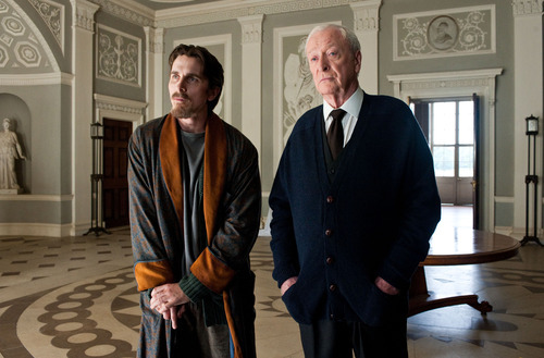This undated film image released by Warner Bros. Pictures shows Christian Bale as Bruce Wayne, left, and Michael Caine as Alfred in a scene from the action thriller