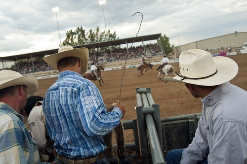Chris Detrick  |  The Salt Lake Tribune Tag Elliott, of Thatcher, watches the saddle bronc competition during the Dinosaur Roundup Rodeo Friday July 13, 2012. Tag Elliott was ranked 24th in the world when he was injured while attempting to ride a bull named Werewolf at the 2007 Days of '47 rodeo.