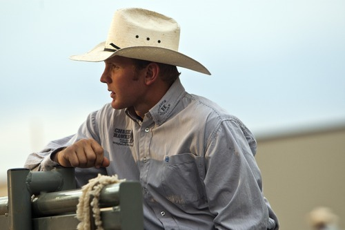 Chris Detrick  |  The Salt Lake Tribune Tag Elliott, of Thatcher, watches the bull riding competition during the Dinosaur Roundup Rodeo Friday July 13, 2012. Tag Elliott was ranked 24th in the world when he was injured while attempting to ride a bull named Werewolf at the 2007 Days of '47 rodeo.