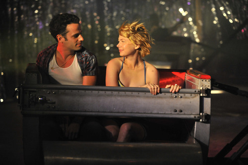 Luke Kirby, left, and Michelle Williams in a scene from