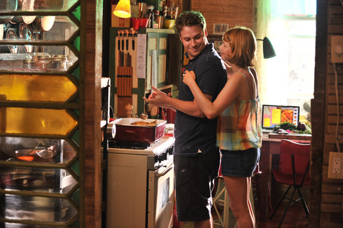 Seth Rogan, left, and Michelle Williams are shown in a scene from
