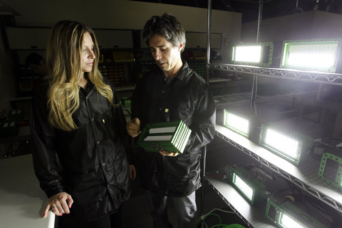 Al Hartmann  |  The Salt Lake Tribune Angela and James Saffari, owners of Dynotron look over completed 96 LED