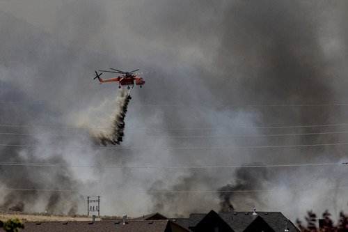A helicopter drop at the Saratoga Springs Dump Fire. Courtesy Larry Latimer